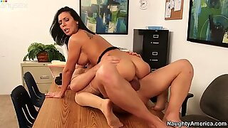 Bootylicious brunette milf Rachel Starr rides cock on the table in the office